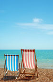 Two deck chairs on the beach — Stock Photo
