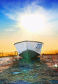 Boat at sunrise — Stock Photo
