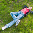 Boy Lying On The Fresh Green Grass — Stock Photo