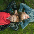 Kids Lying On The Grass — Stock Photo