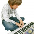 Cute kid playing piano, isolated — Zdjęcie stockowe #6016760