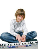 Cute kid playing piano, isolated — Stock Photo