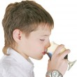 Boy drinking a glass of soda — Stock Photo #6025355