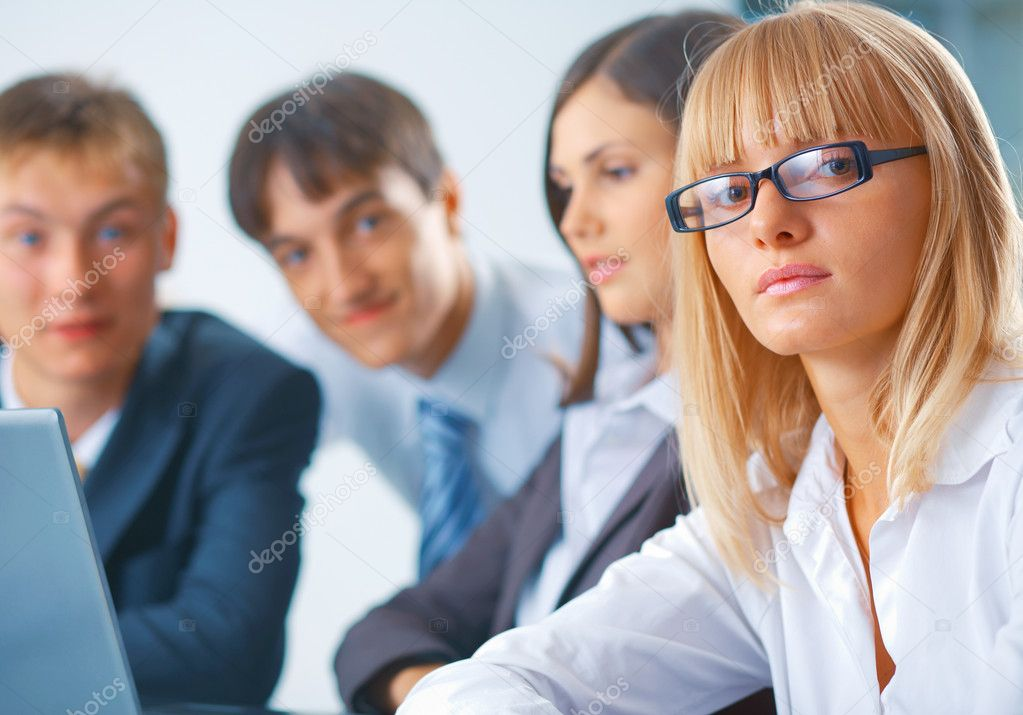 Portrait of young serious woman with her team — Stock Photo #5482407