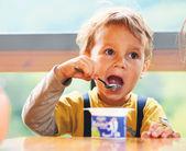 Little Boy Is Eating Yogurt. — Stock Photo
