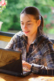 Young woman using her laptop outdoors. — Stock Photo