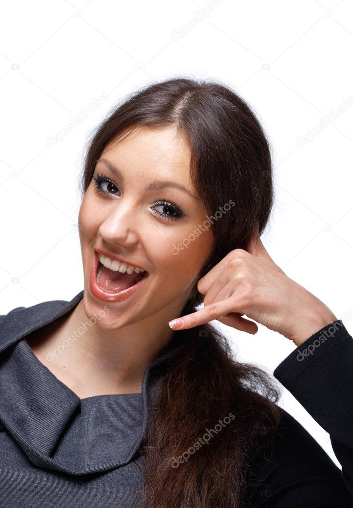 Portrait of a happy young female gesturing a call me sign isolated on white background.  Stock Photo #5871496