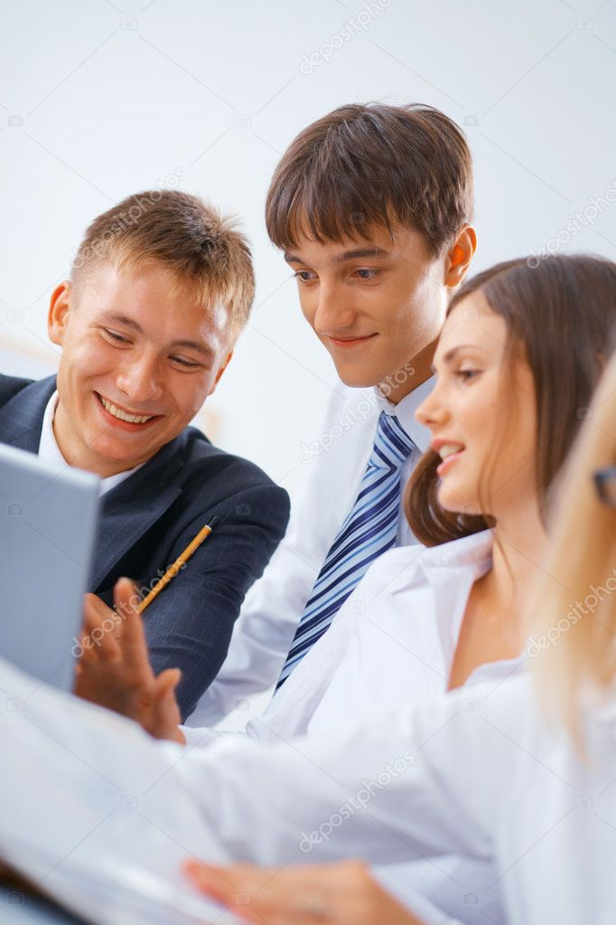 Portrait of young happy working business team — Stock Photo #5871639