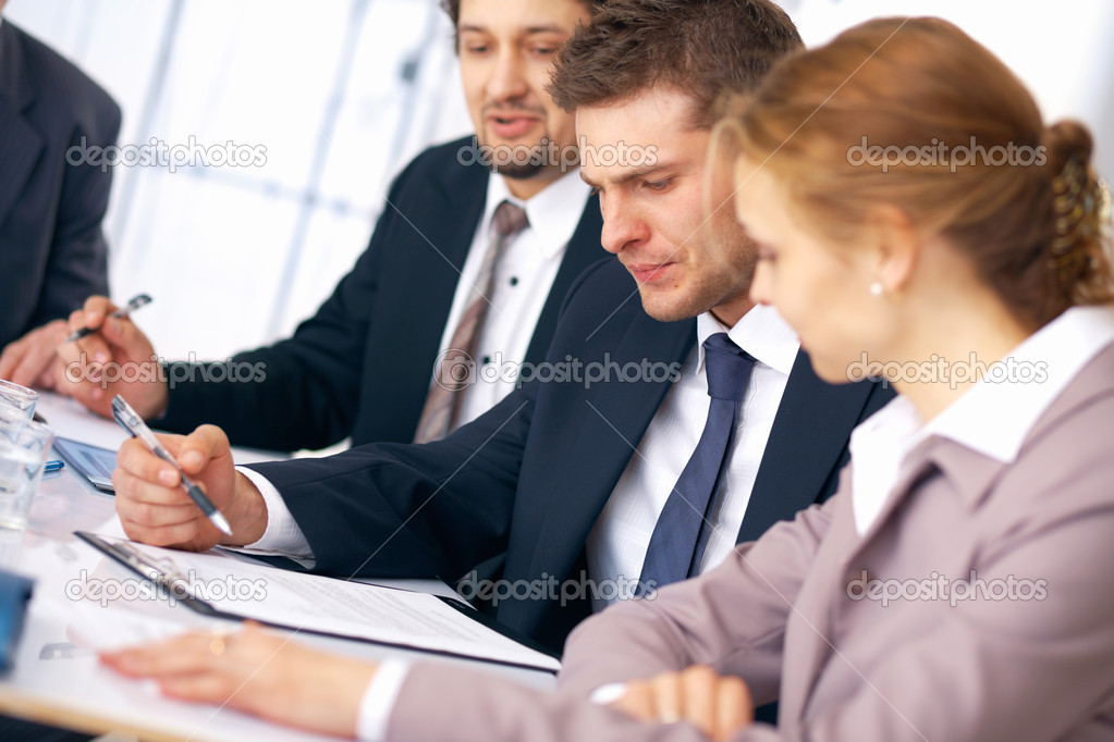 Group of business working on some documents at the office. — Stock Photo #5971096