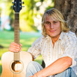 Caucasian guitar player - Stock Photo