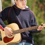 Young asian guitar player — Stock Photo #5453528
