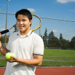 Asian man playing tennis — Stock Photo