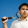 Asian male playing tennis — Stock Photo