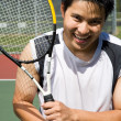 Young asian tennis player — Stockfoto