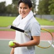 Young asian tennis player — Stock Photo #5453592
