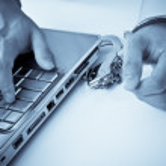 Handcuffed businessman on laptop — Stock Photo