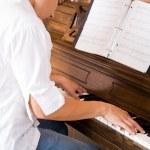 Asian playing piano — Stock Photo