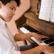 Asian playing piano — Stock Photo