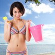 Black bikini woman at the beach — Stock Photo