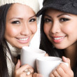 Asian women drinking coffee - Stock Photo
