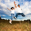 Asian couple jumping for joy — Stock Photo #5453777