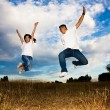 Asian couple jumping for joy — Stock Photo #5453778