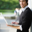 Asian student with laptop - Photo