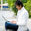 Asian college student and laptop — Stock Photo