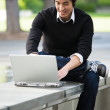 Asian student and laptop — Stock Photo
