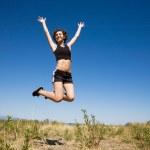 Caucasian girl jumping for joy — Stock Photo #5453948