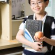 Studying kid with an apple — Stock Photo
