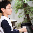 Stock Photo: Playing piano