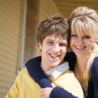 Caucasian couple in front of house — Stock Photo #5454212