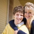 Caucasian couple in front of house — Stock Photo
