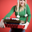 Caucasian girl carrying gifts — Stock Photo