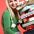 Caucasian girl with gifts on holiday — Stock Photo #5454292