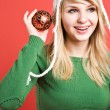 Stock Photo: Caucasian girl with christmas ornament