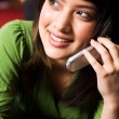 Asian girl on the phone - Stock Photo