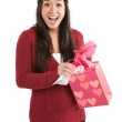 Surprised asian girl receiving valentine gift — Stock Photo #5454509