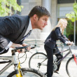 Business racing on bicycles — Stock Photo