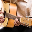 Stock Photo: Senior man playing guitar