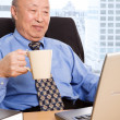 Working senior asian businessman — Stock Photo #5454870