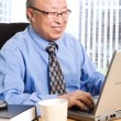 Stock Photo: Working senior asian businessman