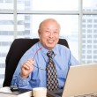 Working senior asian businessman — Stock Photo #5454873