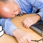 Senior asian businessman sleeping — Stock Photo