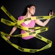 Businesswoman trapped in caution tape - Stock Photo