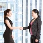 Two businesswomen shaking hands — Stock Photo