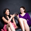 Beautiful women drinking at a party — Stock Photo