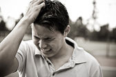 Sad and stressed young asian male — Stok fotoğraf