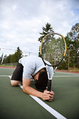 Sad tennis player after defeat — Stock Photo
